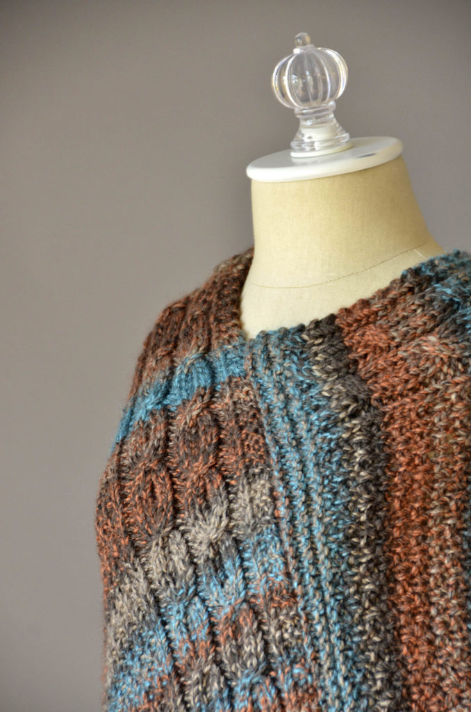 double-cable-poncho-three-quarter-detail-blog