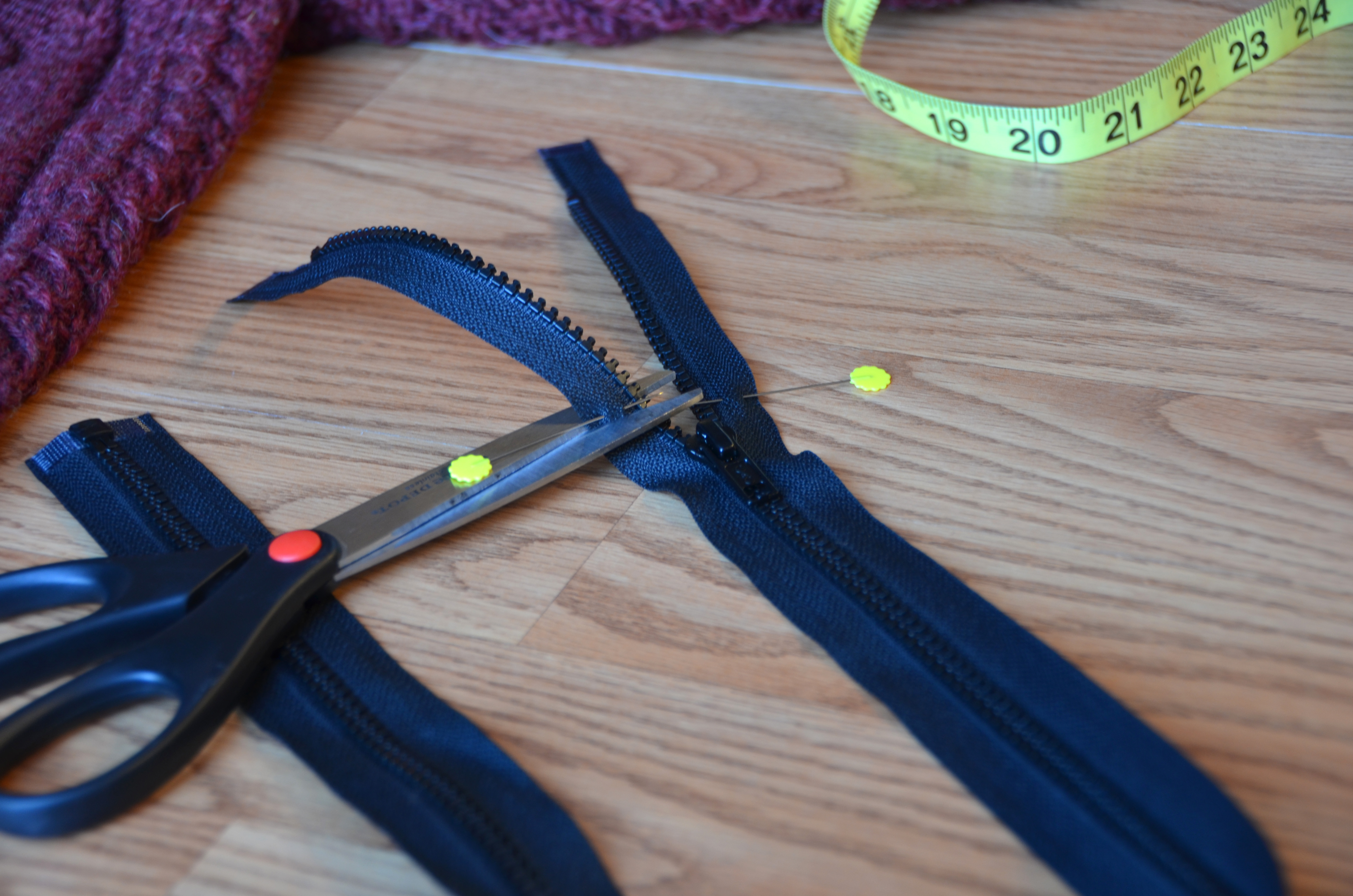 Don't accidentally slide your zipper over the top of your just-cut end!