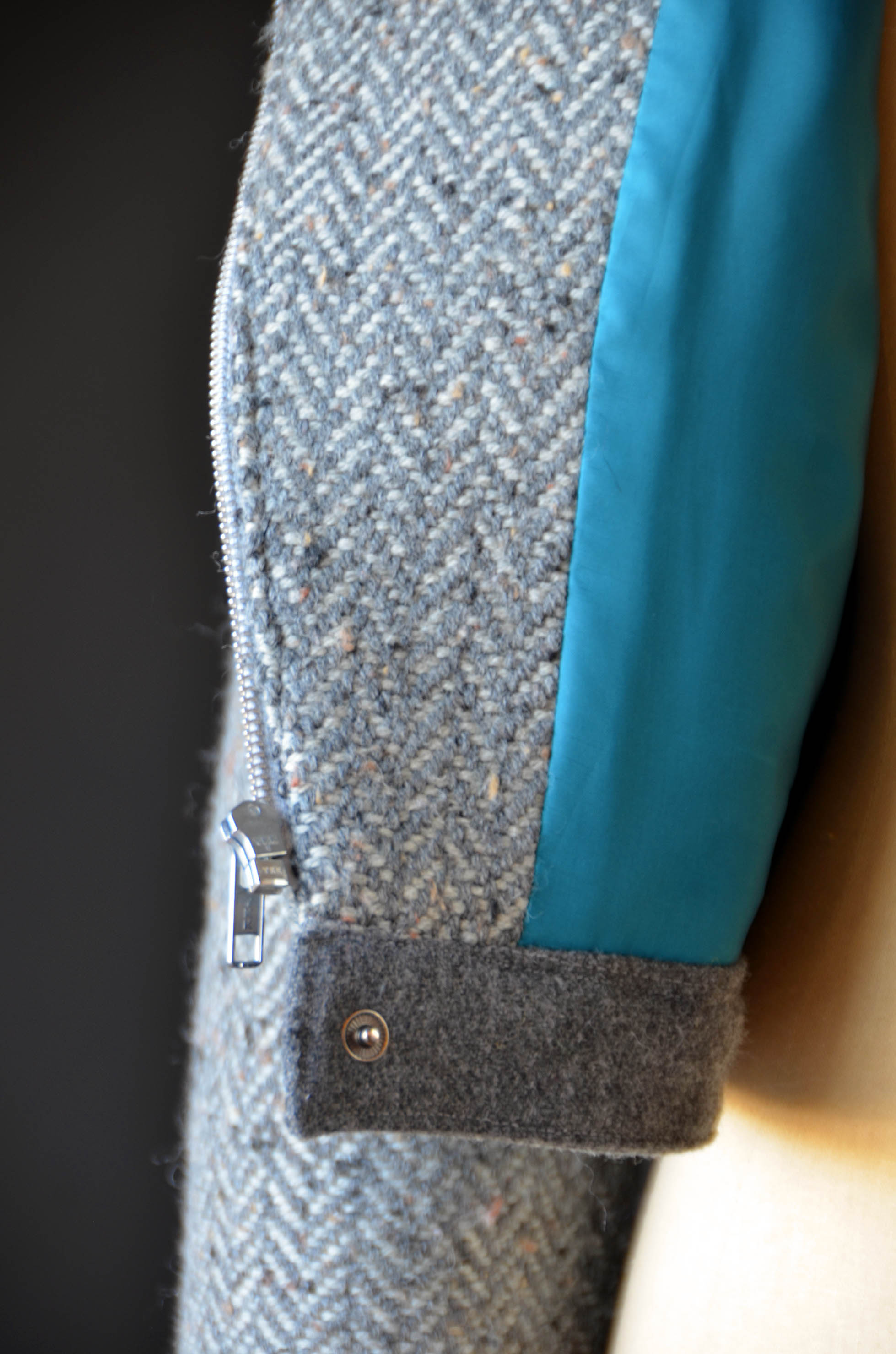 My pop of color is on the inside of my jacket in the form of teal lining. Mmmm.