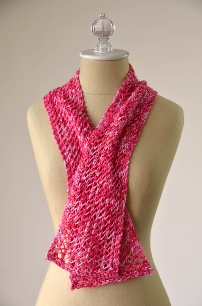 red lace cotton scarf on a tan dressform