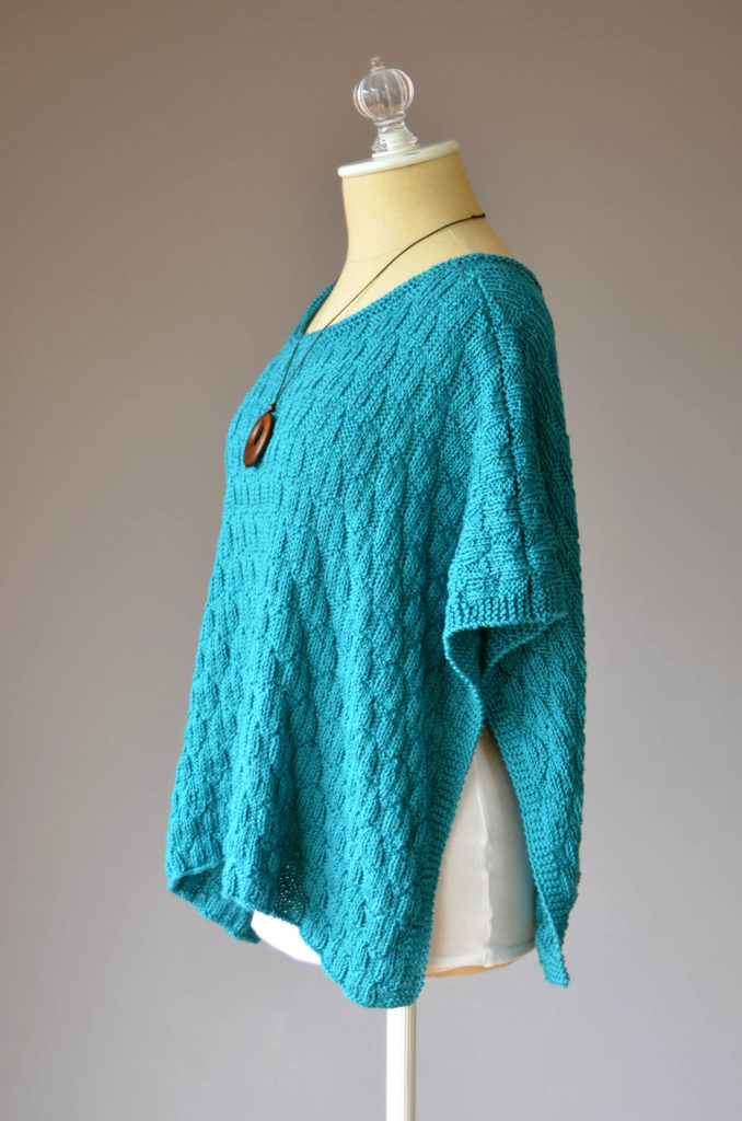 side view of aqua poncho