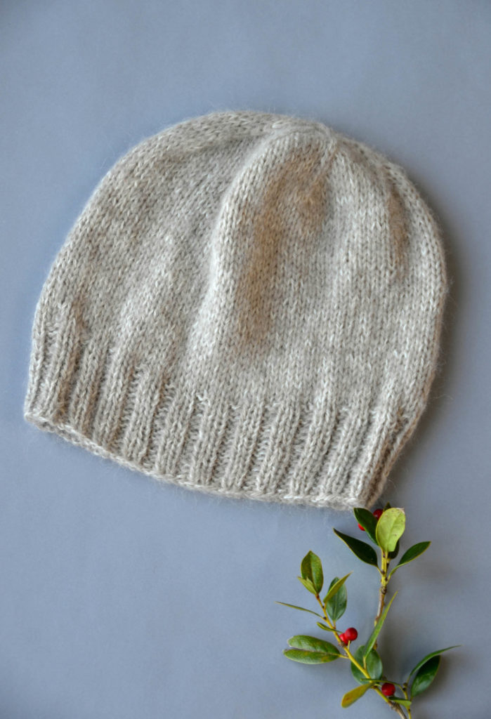 Image of an oatmeal-colored hat on a gray background