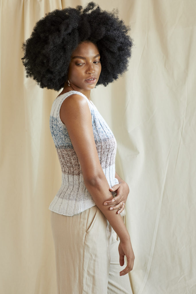 Side view of woman wearing knitted ribbed tank top
