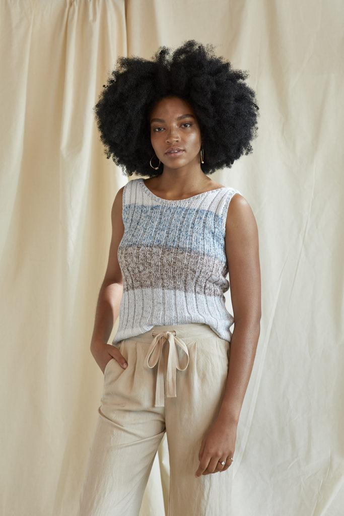 Woman wearing tank top knitted in Cotton Supreme Waves